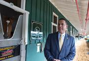 Lt. Gov. Anthony Brown visits with Preakness contender Goldencents in the Pimlico stakes barn.