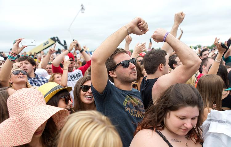 Fans dance along to Macklemore in the infield during the 2013 Preakness.