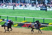 Hall of Fame jockey Gary Stevens, right, rides Oxbow to victory in the Preakness Stakes at Pimlico Race Course on Saturday.