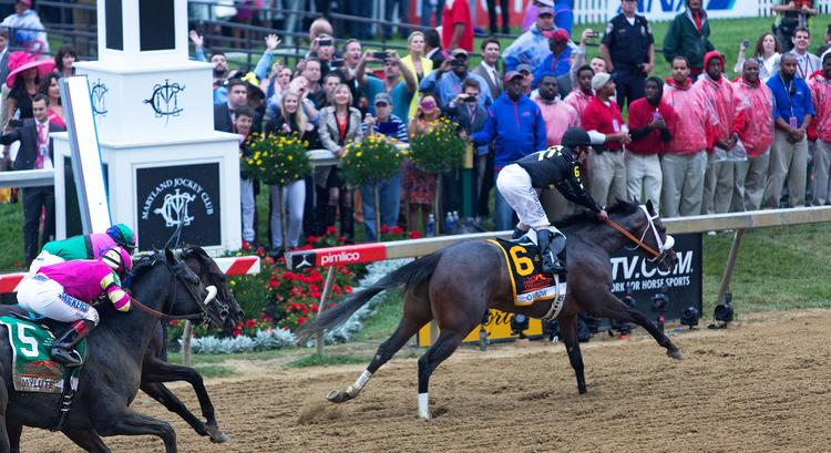 Gary Stevens, right, rides Oxbow to victory in the 2013 Preakness Stakes at Pimlico Race Course.