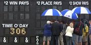 Rain, at times, put a bit of a damper on the festivities during Preakness at Pimlico Race Course on Saturday.