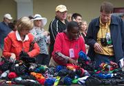 People collect the umbrellas that were confiscated by security as they entered during Pimlico Race Course on Saturday.