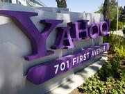 A senior director who works on Yahoo's mobile efforts is being sued for sexual harassment.