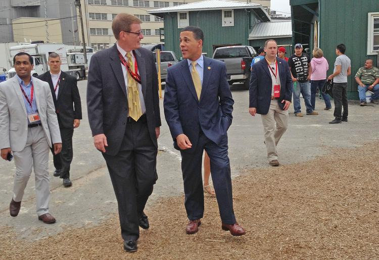 Maryland Jockey Club President Tom Chuckas, left, and Lt. Anthony Brown tour the Pimlico stakes barn on Saturday.