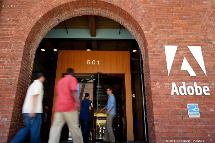 People enter the Adobe Systems Inc. office in San Francisco, Calif. The largest maker of graphic-design software is among the companies expected to release earnings on Tuesday.