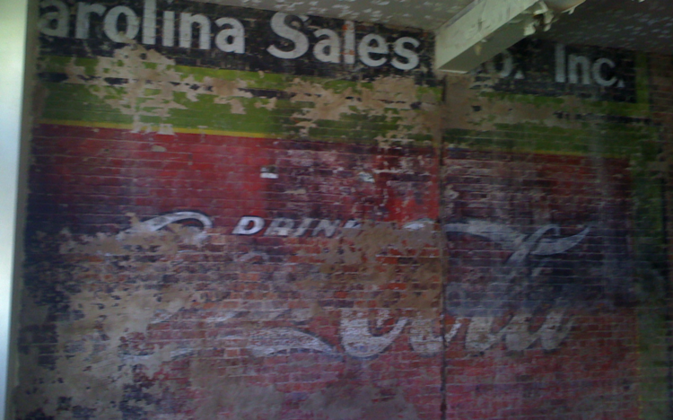 An old Coca-Cola mural is being revealed in Durham.