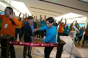 John Case, corporate vice president, Office Division, Microsoft, cuts the ribbon with Gonzalo Di Paolo, store manager, at the new Microsoft store at Dadeland Mall.