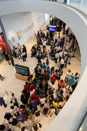 Excited customers gather in anticipation of the grand opening of the new Microsoft store at Dadeland Mall.