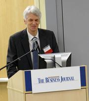 Mark Sutter, the editor of The Business Journal, speaks to the audience at the State of Davidson.