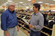 H. Dale Keeton, director of church and community relations for the store, and Zamora discuss B-Thrifty.
