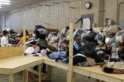 In the back of the store, workers will sort through items and determine what to keep on the retail floor and what to repackage and resell through B-Thrifty's clothing recycling program.