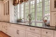 The kitchen features a number of high-end appliances, plus hand-crafted cabinets and granite counters.
