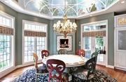 The rotunda-style breakfast area has a hand-painted fresco by Gary Lord and a walk out to the screened porch.