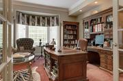 The library has custom moldings and a bay window.