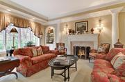The formal living room has a marble hearth.