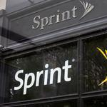 Sprint slices severance pay in half