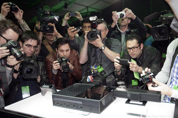 Members of the media take photos and shoot video at the unveiling for Microsoft Corp.'s first new Xbox in almost eight years.