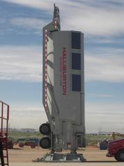"""Halliburton is introducing its """"SandCastle,"""" the first major solar-powered piece of equipment in the oilfield service sector, to Colorado customers. The vertical storage bin for sand uses gravity to feed sand into the fracking operation instead of diesel-fueled pumps. The SandCastle can help reduce the physical footprint of a wellsite as well as air emissions during operation."""