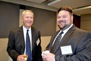 Bill Emrich, left, of District Creative Printing and Michael Dunn of Seyfarth Shaw.