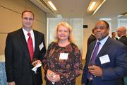 From left, Scott Davis of Reliable Government Solutions, Rebecca Bjork of Seyfarth Shaw and Michael Holiday.