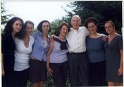 NEXT CALLING: Dr. Saul Rivkin (third from right), on July 1 will turn his full attention to the Marsha Rivkin Ovarian Cancer Research Center, named in memory of his late wife. The center is very much a family affair. Standing with Rivkin are (from left) daughters Amy Germany, Heidi Rivkin and Rebecca Rivkin; current wife, Joyce Rivkin; and daughters Melissa Rivkin and Jessica Rivkin.