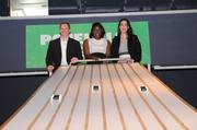 Michael Connolly, Jessica Burns and Ophelia Bernal-Mora race down the Pinewood Derby in the Science Park gallery.