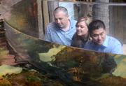 Kevin Adams, Sheena Fowler and Min Cho take a look at the aquarium in the Nature Works gallery.