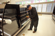 Daniel Rogoveanu of Source Refrigeration & HVAC Inc. tests refrigeration units for fresh foods.
