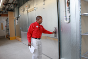 Vincson Green, manager of the Portland CityTarget at The Galleria, checks a refrigeration unit.