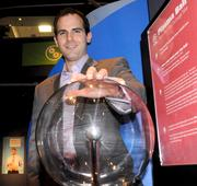 Scott Abramson attracts electrical charges from a plasma ball. Did I mention no executives were harmed? They're all fine.