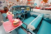Ken Roberts showcases this classic convertible in a drive-in setting.