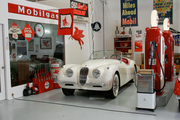 Ken Roberts created a filling station, where he's parked his classic Jaguar.