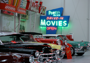 Vintage cars and neon signs fill a refurbished barn outside the home of Ken Roberts.