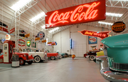 A 6-by-20-foot neon Coca-Cola sign dangles in the middle of the 6,600 square-foot space that is home to Ken Roberts' collection.