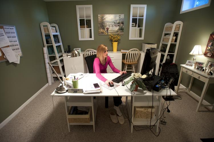 Automatic Data Processing Inc. employee Sheri Scott's home office is in her basement.