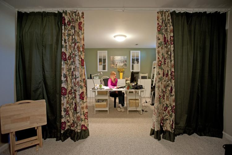 Her walls may be curtains, but Sheri Scott has created a private office in her basement where she works for Automatic Data Processing Inc.