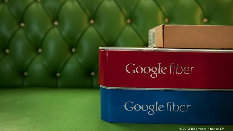 Boxes of equipment needed to install Google Fiber broadband network sit on a couch at the home of a customer in Kansas City, Kan.