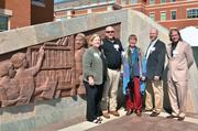 """CBJ Seen: On April 22, officials at UNC Charlotte dedicated the new Cato Teaching Discovery Mural, which features North Carolina history and culture on eight panels rising 8-feet high. The design team from left: Emmy Lou Burchette, Steve Ratzlaff, Mara Smith, Dennis Walls, Richard Petersheim.Want to have your company's events featured in CBJ Seen? Submit them to Alison Angel at aangel@bizjournals.com for consideration. Be sure to include caption information, and put """"CBJ Seen"""" in the subject line."""