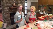 """From our CBJ Seen feature: Building Owners and Managers Association volunteers helped cook dinner for families at the Ronald McDonald House last month. Pictured from left: Cassy Roth and Angela Ownbey.Want to have your company's events featured in CBJ Seen? Submit them to Alison Angel at aangel@bizjournals.com for consideration. Be sure to include caption information, and put """"CBJ Seen"""" in the subject line."""