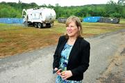 Staff writer Susan Stabley's coverage this week features Advantage Waste Recycling & Disposal Inc., a Charlotte-based company that has plans to open a sister business by September that takes building materials destined for landfills and resells them. Pictured here is Carole McLeod, owner, on the Mount Holly site of the new construction-waste recycling center. Click here to read the story.