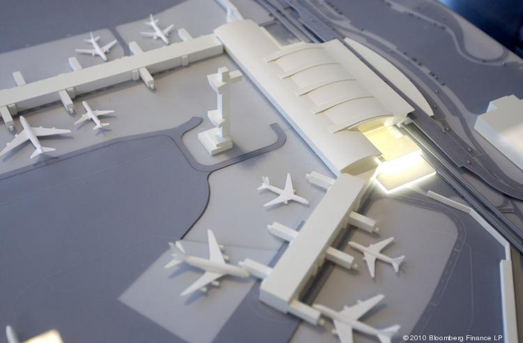 A model of Terminal 4 sits on display during a groundbreaking ceremony at John F. Kennedy International Airport in New York, U.S., on Friday, Nov. 19, 2010.
