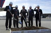 Jos Nijhuis, president of the management board for Schiphol Group NV, from left, U.S. Representative Gregory Meeks, Richard Anderson, chief executive officer of Delta Air Lines Inc., Chris Ward, executive director of Port Authority of New York and New Jersey, and Alain Maca, president of JFK International Air Terminal LLC, get ready to break ground during a ceremony for the new Terminal 4 at John F. Kennedy International Airport in New York, U.S., on Friday, Nov. 19, 2010. Delta, JFK IAT LLC, and the Port Authority of New York and New Jersey today broke ground on the $1.2 billion project that will enhance and expand Terminal 4 at the airport. Photographer: Jin Lee/Bloomberg *** Local Caption *** Jos Nijhuis; Gregory Meeks; Richard Anderson; Chris Ward; Alain Maca