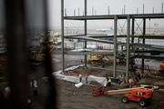 Work continues at a construction site at terminal 4 at John F. Kennedy International Airport in New York, U.S., on Wednesday, Nov. 16, 2011. Delta Air Lines Inc. plans to add a dozen new daily flights from New York to the Caribbean and U.S. locations in 2012 as it competes with United Continental Holdings Inc. in the nation's busiest aviation market. Photographer: Scott Eells/Bloomberg