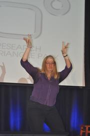 Janet Kennedy of the Triangle Interactive Marketing Association dances to Michael Jackson beats.