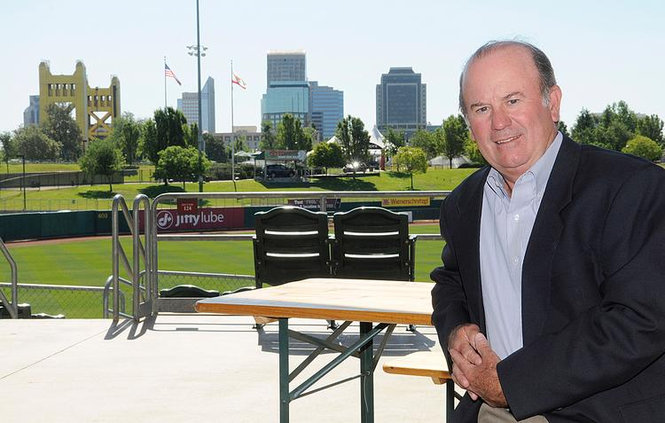 "Sacramento River Cats CFO Dan Vistica, with Raley Field and the Sacramento skyline behind him:  ""We've had what we think are appropriate levels of insurance and security in place since we opened the park 13 years ago."""