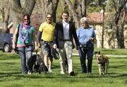 Sean Howley created the annual Feel the Energy 5K to support two Denver charities — Freedom Service Dogs and Family Homestead. Here he visits with Freedom Service Dog client, trainers and dogs in Washington Park. Flanking Howley, left to right, are Jeanelle, a client with her service dog, Dusk; trainer Joe Gutz with Jingle, and Fran Menley with Peak.