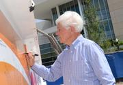 Jim Pugh, chairman of the Dr Phillips Center for the Performing Arts, adds his signature.