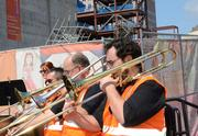 Members of the Brass Band of Central Florida perform before the start of the topping-off ceremony.