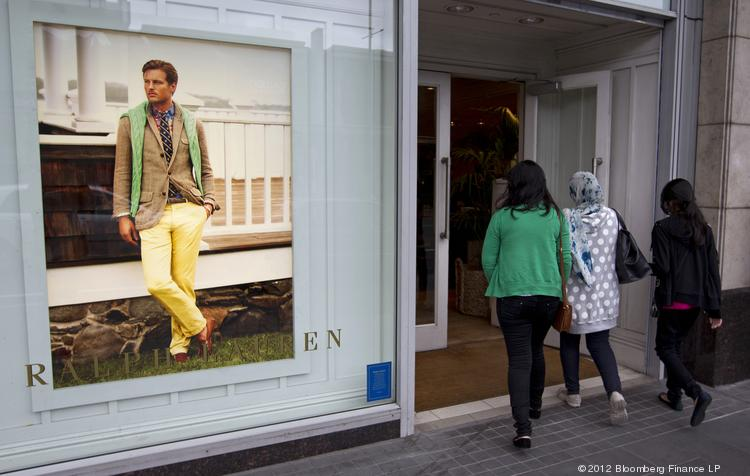 Customers enter a Ralph Lauren Corp. store in Auckland, New Zealand. The company's sales for the most recent quarter were up slightly but disappointed Wall Street.