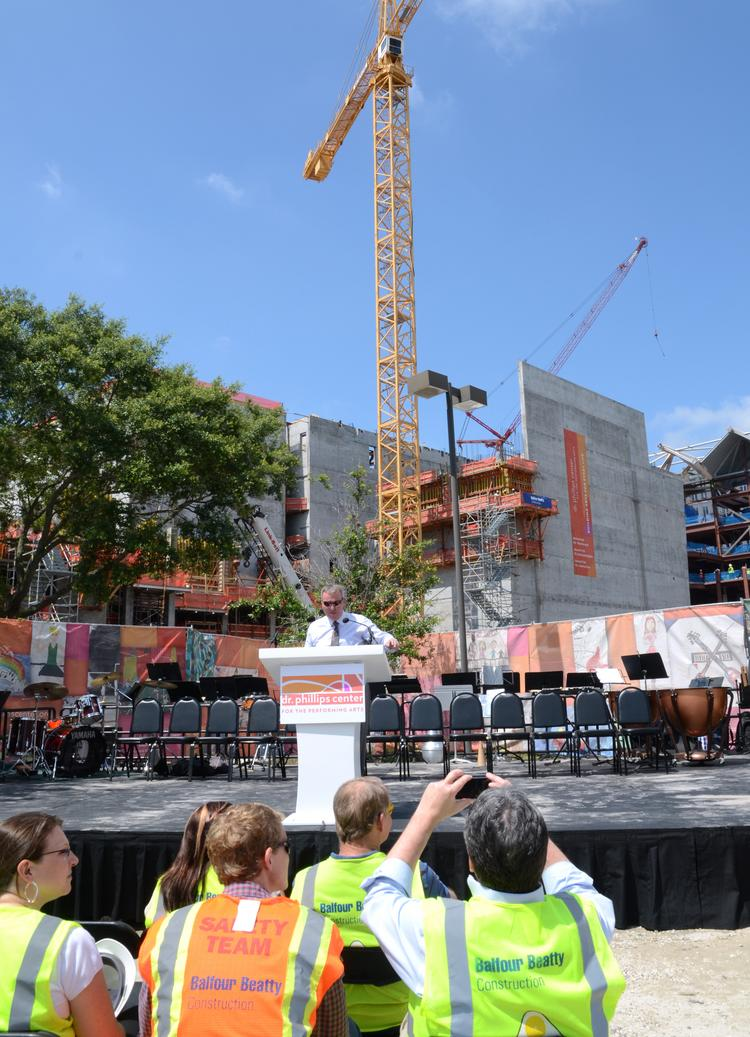 DPAC supporters and media attend the May topping-off ceremony for the downtown arts center.